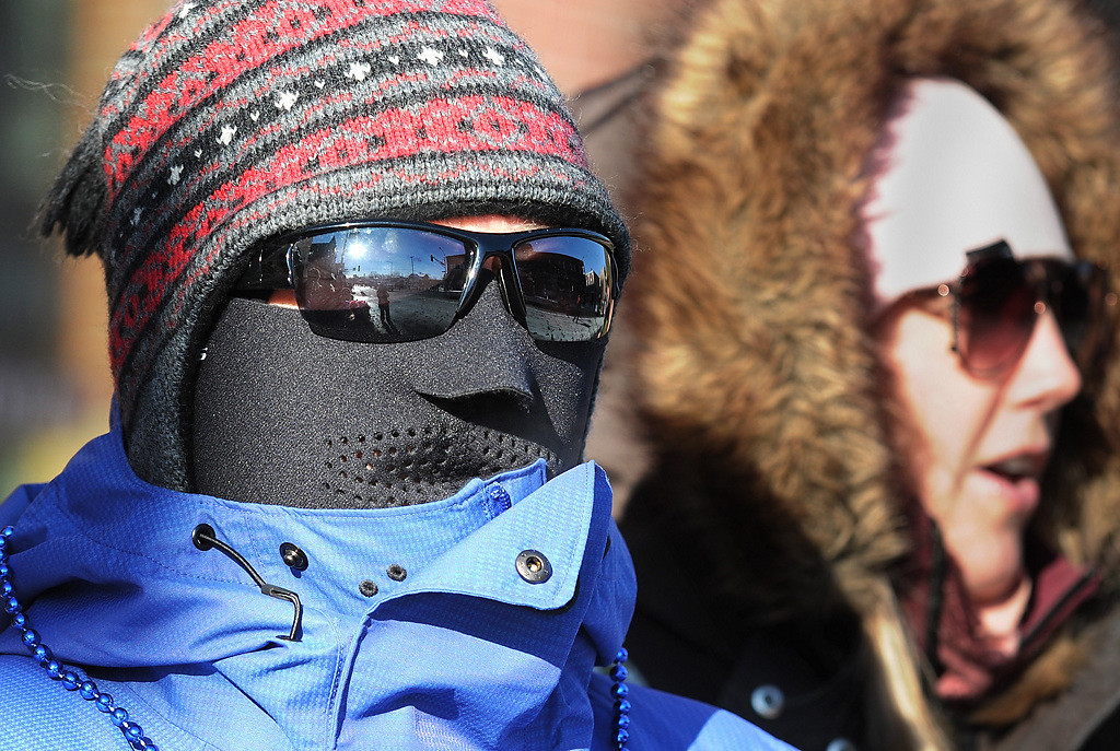 ". ""My husband made me do this,\"" said Cindy Hansen from Eagan about her cold weather head gear at the Winter Carnival Grande Day Parade in St. Paul, Saturday January 25, 2014. She is standing by her daughter, Lindsay Hansen. (Pioneer Press: Jean Pieri)"