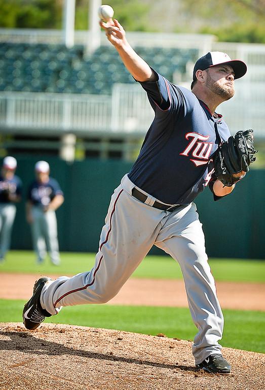 . Pitcher Ricky Nolasco follows through during live batting practice. (Pioneer Press: Ben Garvin)
