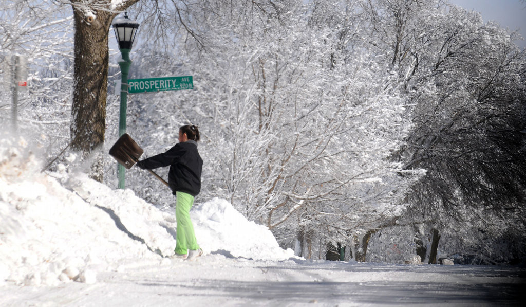 . Missy Juve shovels the street at the intersection of Prosperity Avenue and Ames Avenue East in St. Paul Friday afternoon.  The neighbors at these two streets get together and help each other by cleaning up what the city snow plows miss.  (Pioneer Press: John Doman)