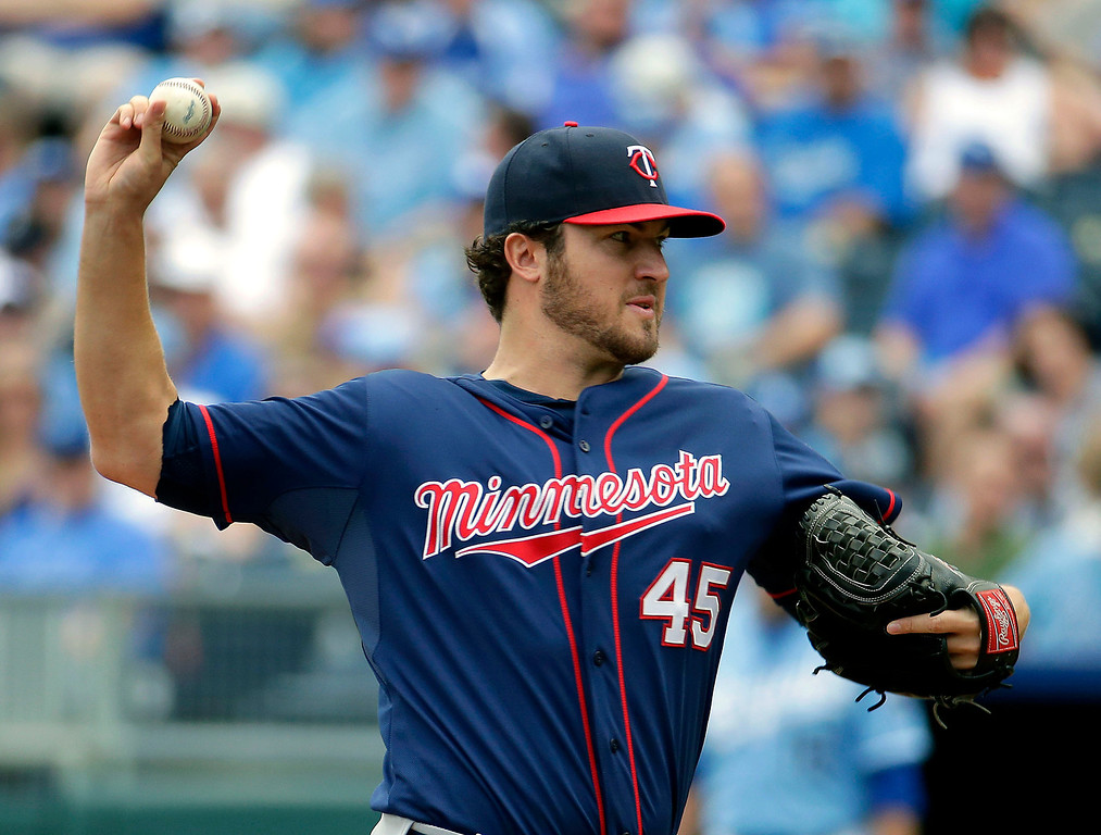 . Minnesota Twins pitcher Phil Hughes throws during the first inning against the Kansas City Royals on Sunday, April 20, 2014, at Kauffman Stadium in Kansas City, Mo. Minnesota won 8-3, giving Hughes his first victory as a Twins player. (AP Photo/Charlie Riedel)