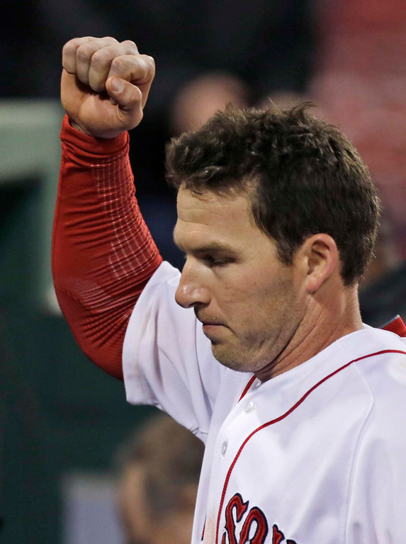 . Boston Red Sox\'s Stephen Drew pumps his fist as he heads to the clubhouse after his game-winning, RBI double in the 11th inning. (AP Photo/Charles Krupa)