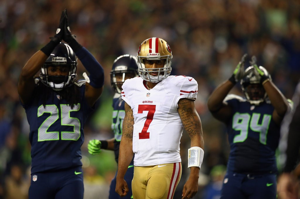 . <p><b> NFC Championship Game</b>  <p><b> 49ers at Seahawks (-3):</b>  <p>Amid all the cruise fun, we�ve felt an occasional twinge of nausea. Not from seasickness, but from the sight of senior citizens proudly displaying their tattoos. Not our cup of tea. But there is certainly no shortage of body art on our fellow travelers. They may be on to something. So in this battle between Colin Kaepernick and Russell Wilson, we�re picking the quarterback with the most tats.  <p>Pick: <b>49ers by 7</b> <p>    (Jonathan Ferrey/Getty Images)