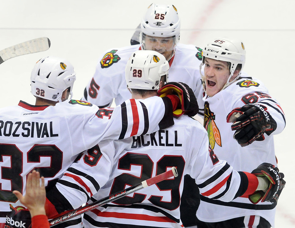 . Chicago players, including center Andrew Shaw, right, celebrate Bryan Bickell\'s goal, center, in the third period against the Wild.  (Pioneer Press: Ben Garvin)