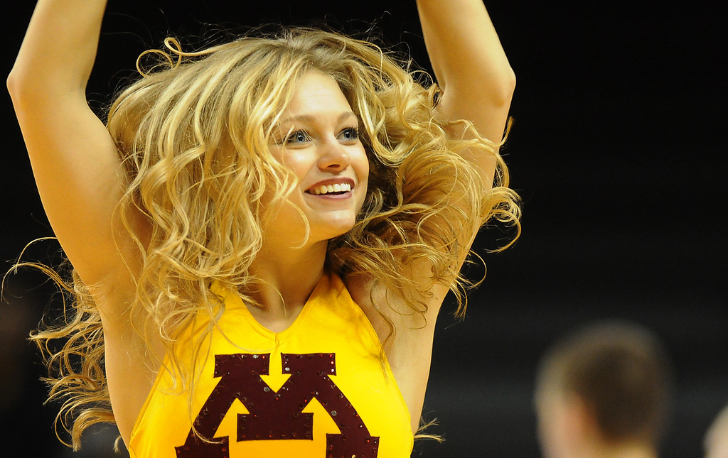 . A Gophers cheerleader celebrates Minnesota\'s 75-59 victory over the South Dakota State Jackrabbits at Williams Arena. (Pioneer Press: John Autey)