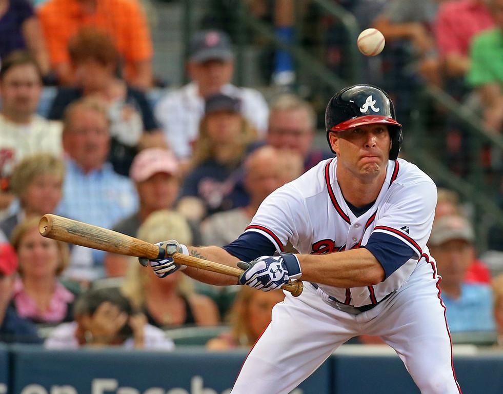 . Atlanta Braves pitcher Tim Hudson bunts during the second inning. (Curtis Compton/Atlanta Journal-Constitution/MCT)