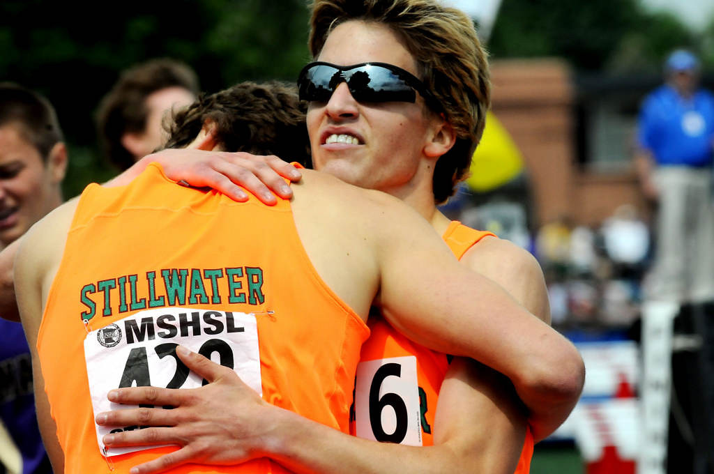 . Stillwater\'s Wayde Hall, right, hugs teammate Eli Krahn after the boys 1600 meters. Krahn won with a tiime of 4:09.38 and Hall was second with a time of 4:10.42. (Pioneer Press: Sherri LaRose-Chiglo)