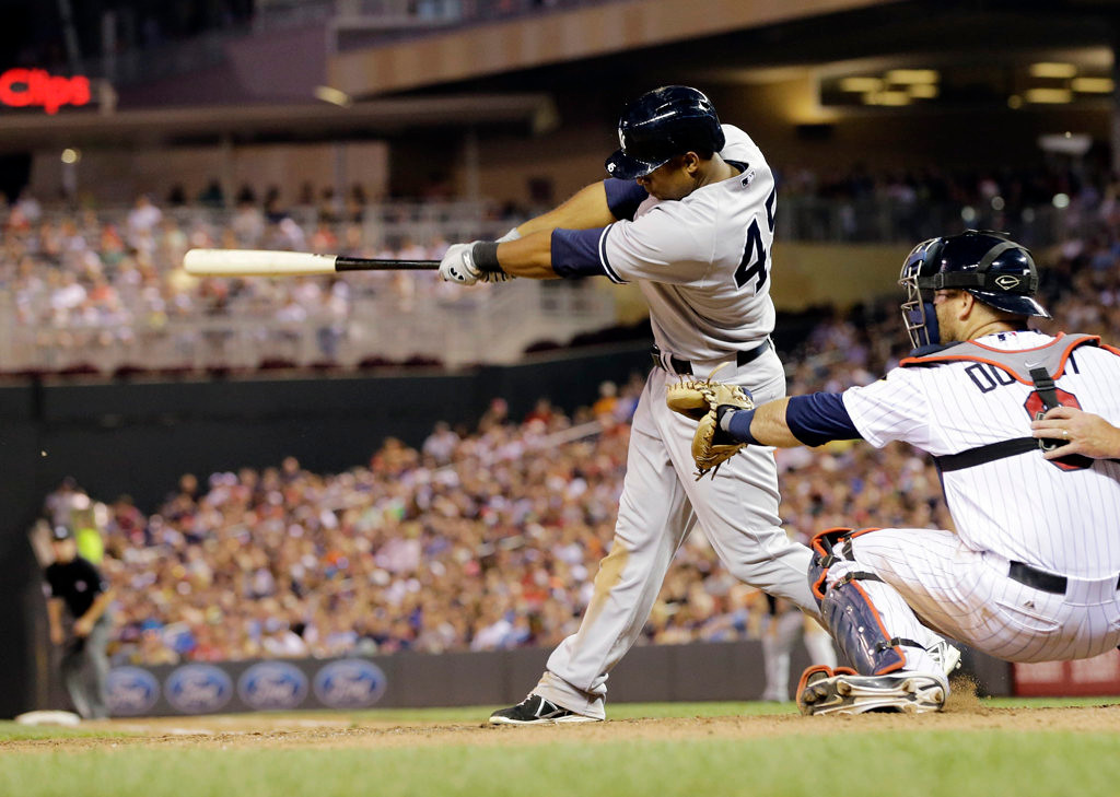 . New York Yankees\' Zoilo Almonte drives in the go-ahead run off Minnesota Twins pitcher Jared Burton in the eighth inning. (AP Photo/Jim Mone)