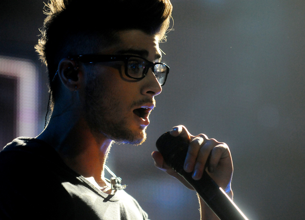 . Zayn Malik with the band One Direction performs during the bands concert at the Target Center, in Minneapolis, Thursday, July 18, 2013.  (Pioneer Press: John Autey)
