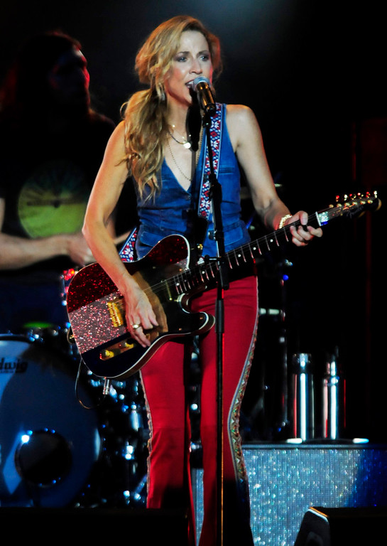 """. Sheryl Crow entertains the crowd with  \""""All I Wanna\"""" at the Minnesota State Fair Grandstand. (Pioneer Press: Scott Takushi)"""