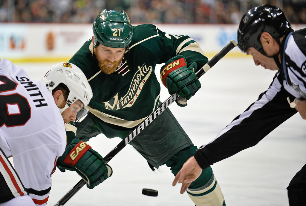 . Wild center Kyle Brodziak faces off with Blackhawks right wing Ben Smith during the second period. (Pioneer Press: Ben Garvin)