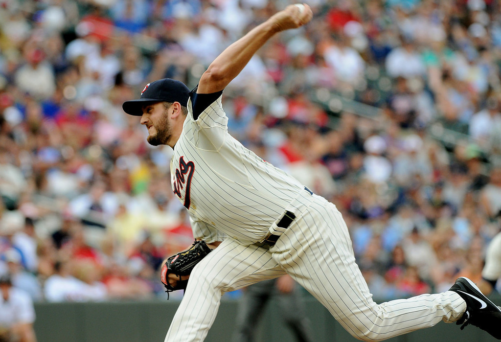 . Minnesota closer Glen Perkins delivers a pitch in the ninth inning. (Pioneer Press: John Autey)