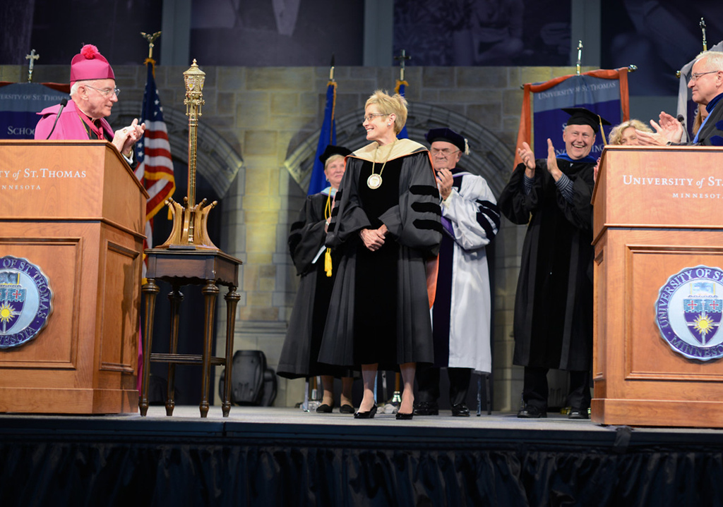 . Dr. Julie Sullivan is congratulated by The Most Reverend Harry J. Flynn, left, and Rev. Dennis Dease, right, president emeritus, after she was inaugurated as the new president of the University of St. Thomas. She succeeded Dease,  who presided over the university for 22 years. (Pioneer Press: Chris Polydoroff)