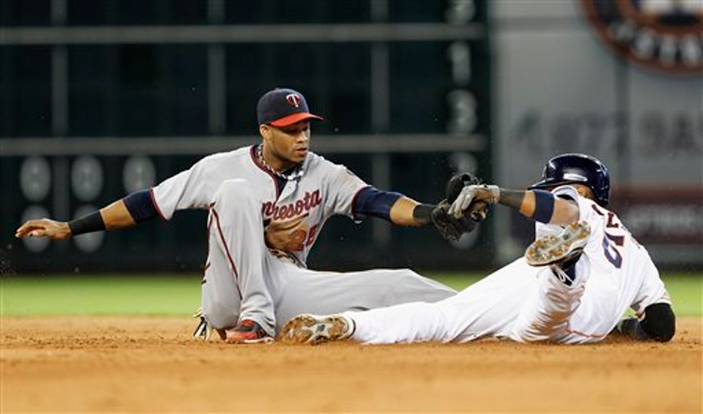 . Houston Astros\' Jonathan Villar  is tagged out by Minnesota Twins shortstop Pedro Florimon (25) attempting to steal second base in the eighth inning. (AP Photo/Bob Levey)