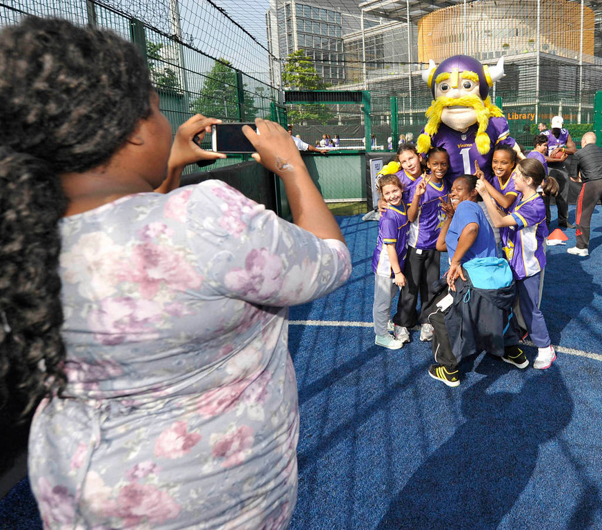. A Minnesota Vikings mascots poses for photos during a clinic for kids at Wembley Stadium. (NFL: Sean Ryan)
