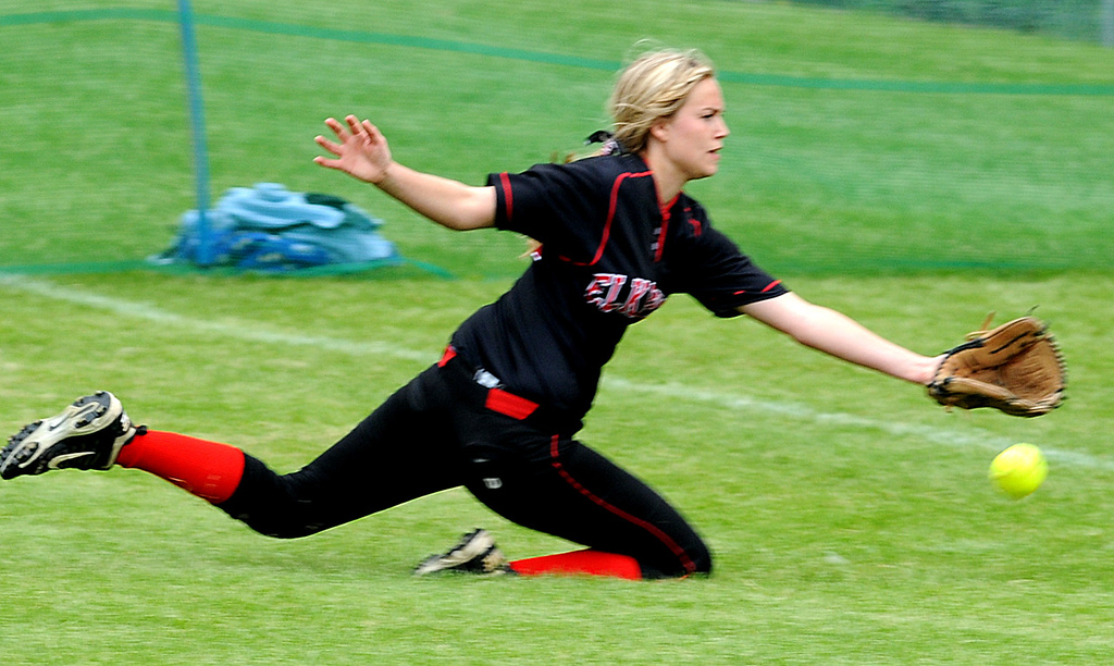 . Elk River\'s Sydney Person stretches but can\'t get to a ball hit by Prior Lake.  (Pioneer Press: Jean Pieri)