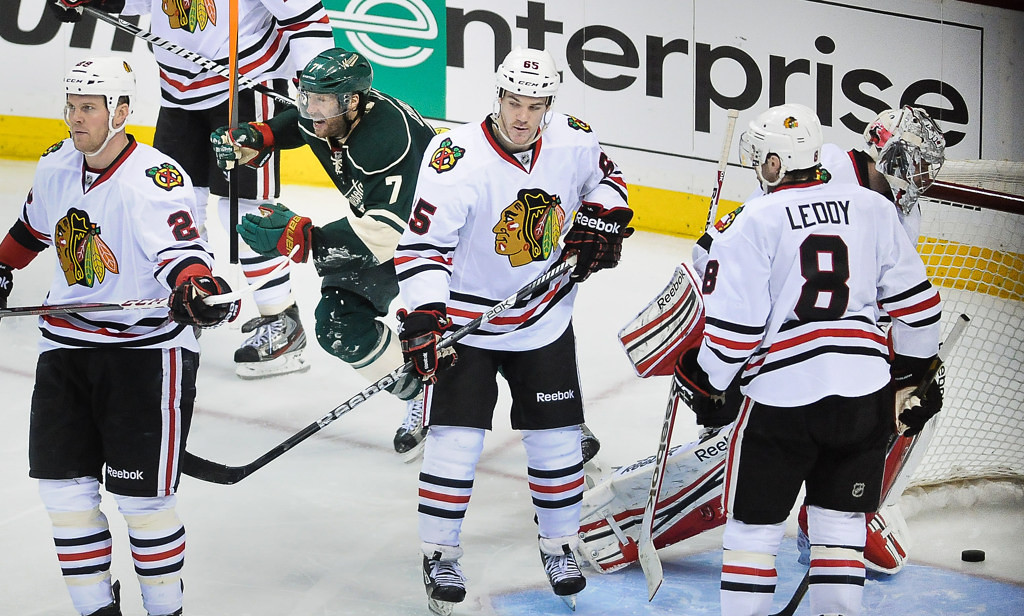 . Minnesota\'s Matt Cullen skates past Chicago players (from left) Bryan Bickell, Andrew Shaw and Nick Leddy after Jason Zucker scored the winning overtime goal.  (Pioneer Press: Ben Garvin)