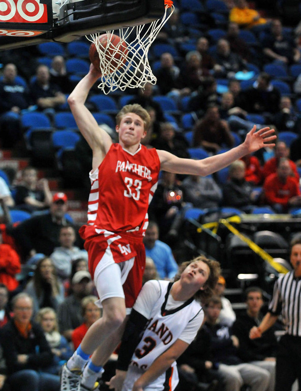 . Lakeville North\'s JP Macura dunks over Grand Rapid\'s Jason Bibeau in the second  half, as Lakeville North beat Grand Rapids. (Pioneer Press: Scott Takushi)