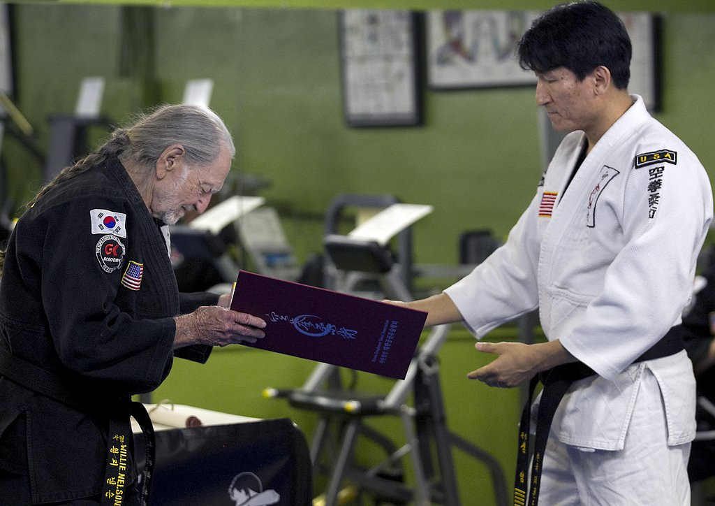 ". <p><b> Country music legend Willie Nelson made news last week when he earned a fifth-degree black belt in this ancient martial art � </b> <p> A. Gong Kwon Yu Sul <p> B. Karate <p> C. Take Weed Doh <p><b><a href=\'http://www.telegraph.co.uk/culture/music/worldfolkandjazz/10794872/Willie-Nelson-gets-5th-degree-black-belt-at-81.html\' target=""_blank\""> LINK </a></b> <p>    (AP Photo/Austin American-Statesman, Ralph Barrera)"