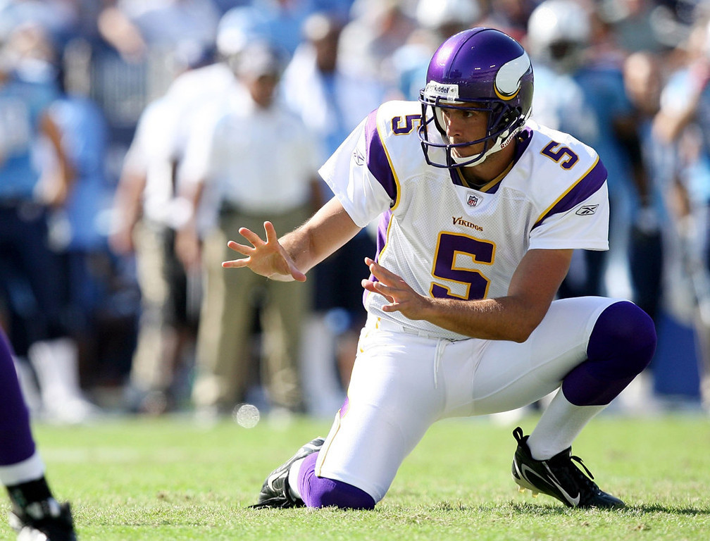 . Vikings holder Chris Kluwe takes the snap during a field goal attempt while taking on the Tennessee Titans at LP Field on September 28, 2008 in Nashville, Tennessee. The Titans defeated the Vikings 30-17.  (Photo by Doug Benc/Getty Images)