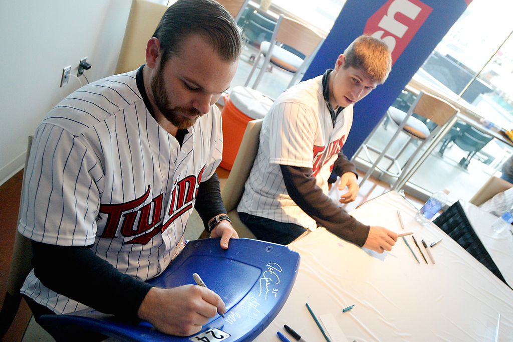 . Former and now current Twin Jason Kubel signs a Metrodome Seat at Twinsfest at Target Field, Saturday, January 25, 2014(Pioneer Press: John Autey)