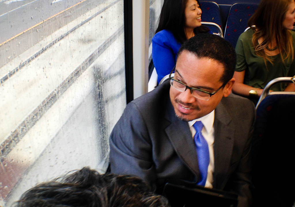 . Congressman Keith Ellison rides the train on opening day of the Metro Transit Green Line light rail train in St. Paul.  (Pioneer Press: Ben Garvin)