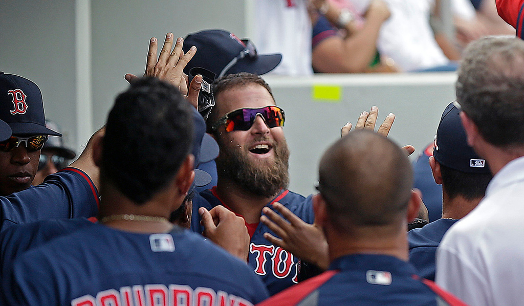 . Boston\'s Mike Napoli celebrates in the dugout after scoring on an RBI double by teammate Mike Carp in the fourth inning against the Twins. (AP Photo/Gerald Herbert)