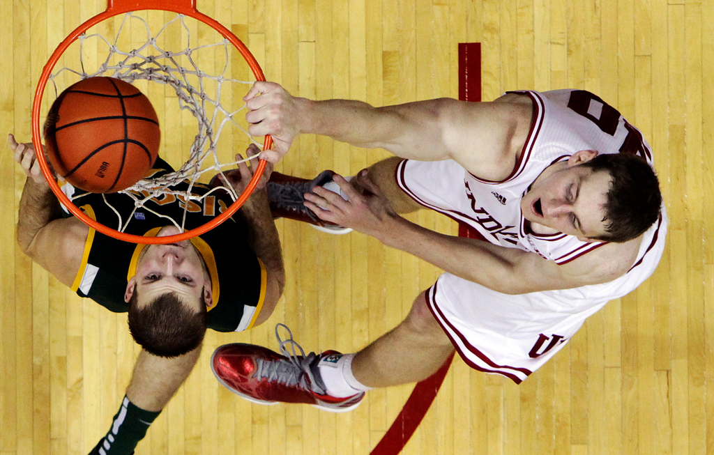 . 10.) Portland Trailblazers -- Cody Zeller (dunking over North Dakota State\'s Taylor Braun, left), power forward/center, Indiana -- Entering last season, Zeller was projected as the No. 1 pick. His stock has dropped, but his jump shot in workouts has been impressive enough to intrigue several teams. (AP Photo/Darron Cummings)