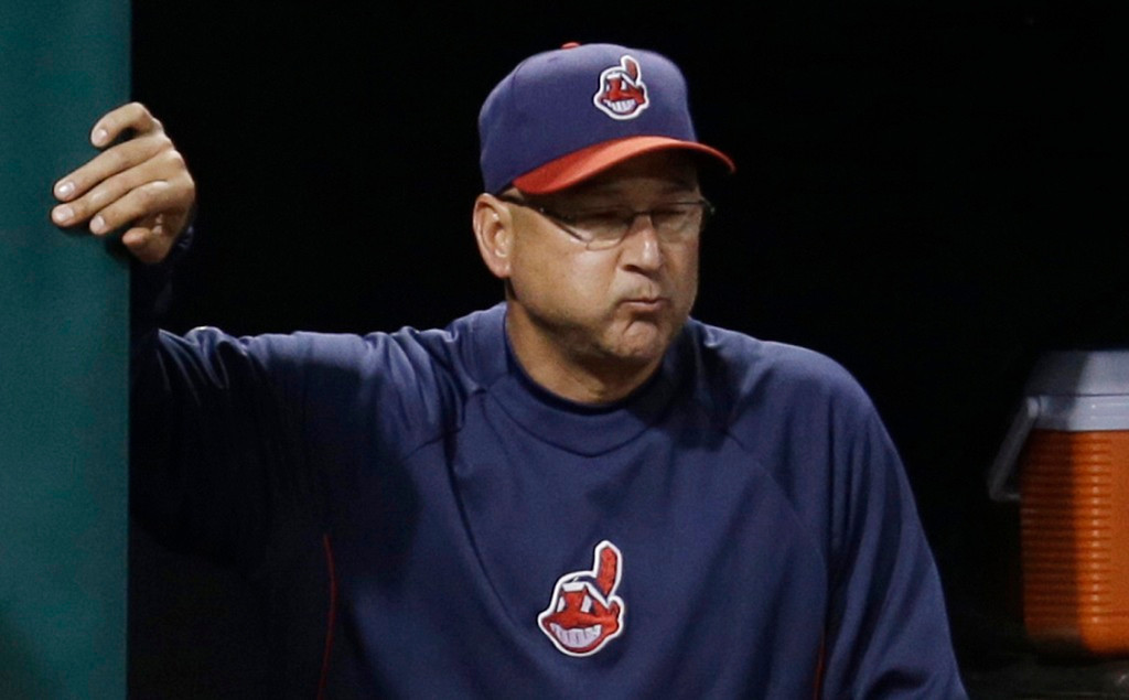 . Indians manager Terry Francona spits while watching his team go down to the Twins in the ninth inning. (AP Photo/Tony Dejak)