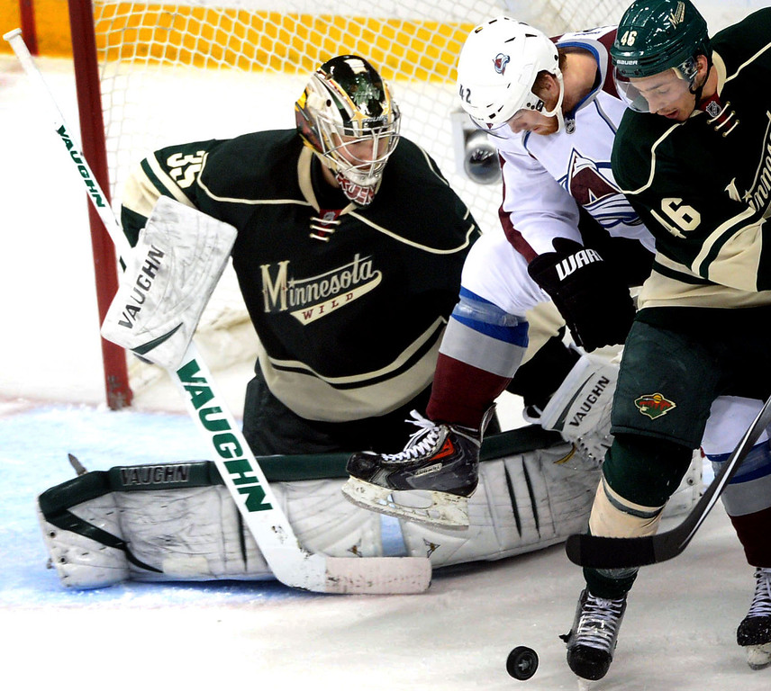 . Minnesota Wild goalie Darcy Kuemper deflects a puck as Colorado\'s Brad Malone puts the pressure on during the second period.  (Pioneer Press: Sherri LaRose-Chiglo)