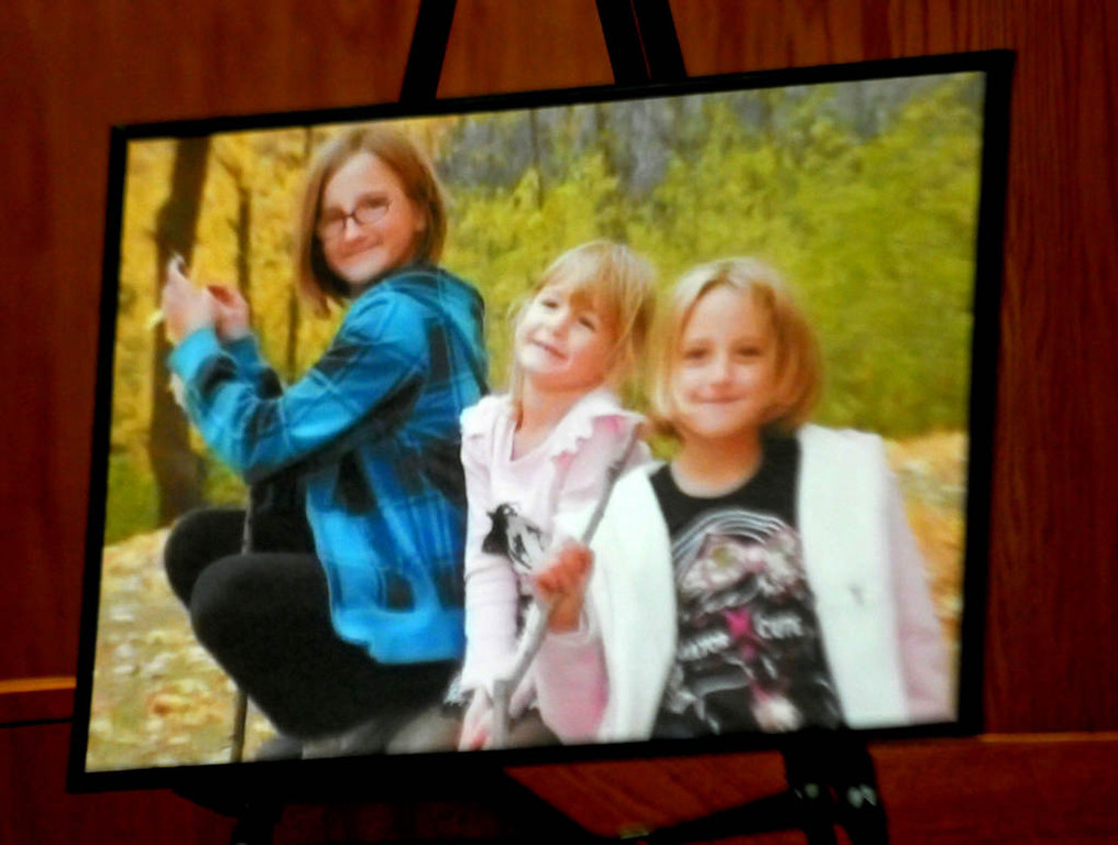 . This portrait of Aaron Schaffhausen\'s daughters -- from left, Amara, 11, Cecilia, 5, and Sophie, 8 -- was on display in the courtroom. (Pioneer Press: John Doman)