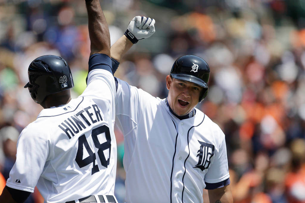 . Detroit Tigers\' Torii Hunter, left, is congratulated after his solo home run by teammate Miguel Cabrera during the first inning. (AP Photo/Carlos Osorio)