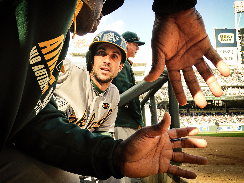 . Oakland\'s Sam Fuld has a word with a coach before batting in the ninth inning against the Twins. (Pioneer Press: Ben Garvin)