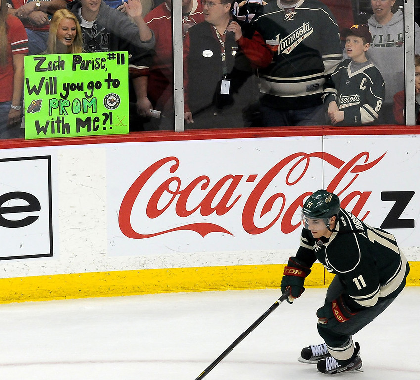 . A Wild fan holds a sign with a question for Zach Parise as he skates by during warm-ups prior to the start of the game against the Los Angeles Kings on Saturday, March 30, 2013, at Xcel Energy Center in St. Paul. (Pioneer Press: Sherri LaRose-Chiglo)