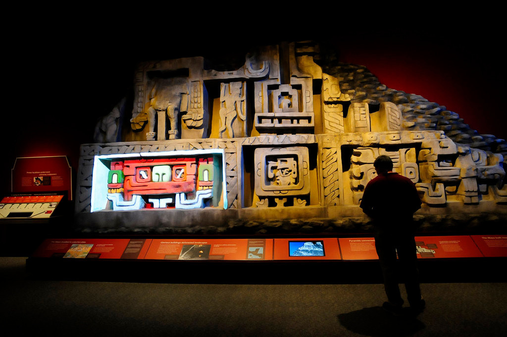 """. A replica of the west facade of the El Castillo pyramid, A.D. 600-800, at Xunantunich, Belize, is part of the \""""Maya: Hidden Worlds Revealed\"""" exhibit that opens Friday, June 21, 2013, at the Science Museum of Minnesota in St. Paul. Mayans built gray stone pyramids and covered them with plaster and stucco decorations painted in red and white, as seen in the lower left panel.  (Pioneer Press: Scott Takushi)"""