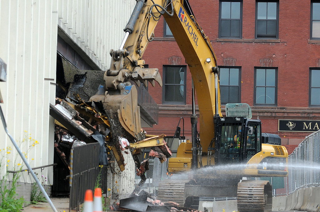 . Saint Paul Saints invited the public for a ballpark site demolition on Saturday, July 13, 2013, at the old Gillette/ Diamond Products building in Lowertown in downtown St. Paul. An excavator took out a small awning.  (Pioneer Press: Sherri LaRose-Chiglo)
