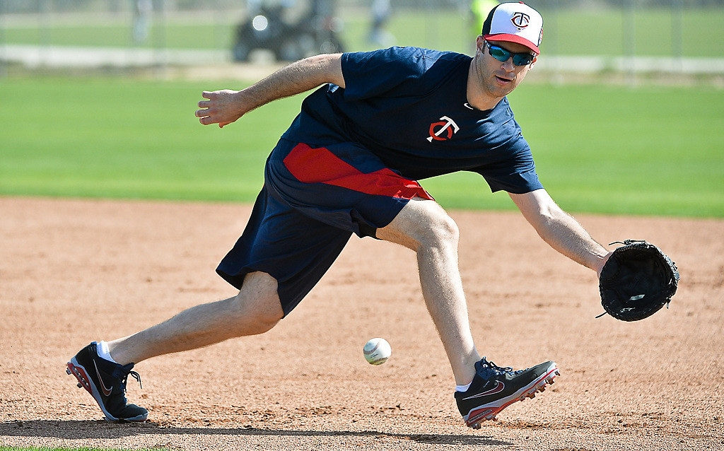 . New Twins first baseman Joe Mauer chases down a grounder during an infield workout.  (Pioneer Press: Ben Garvin)
