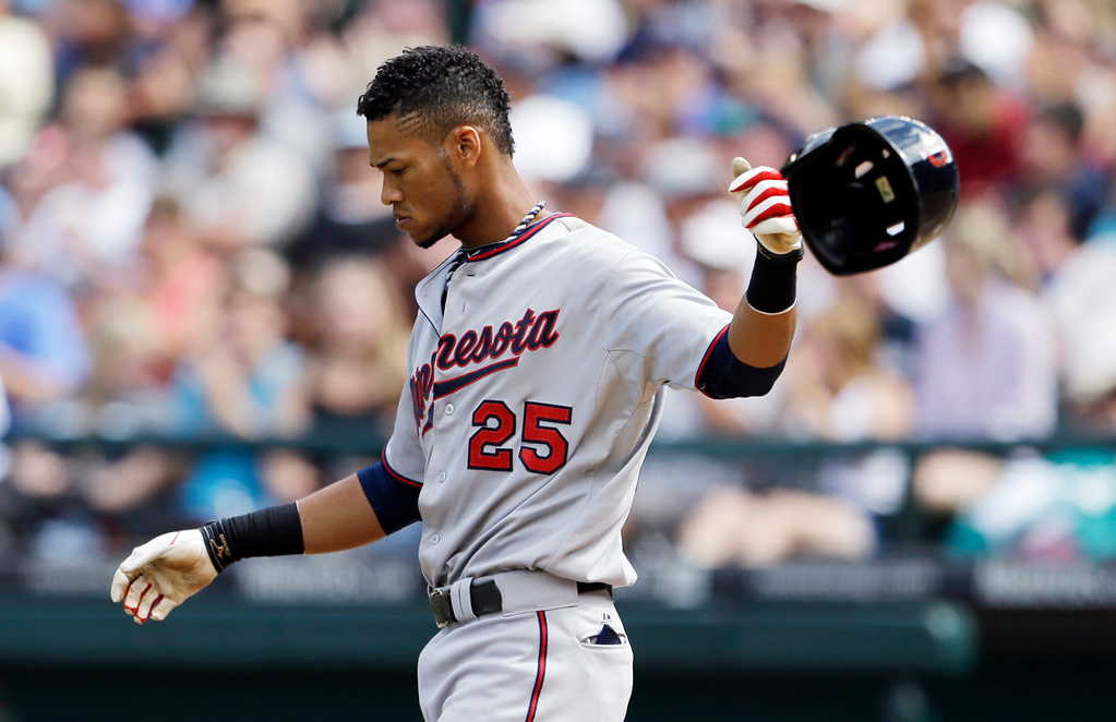 . Minnesota\'s Pedro Florimon tosses his helmet after striking out with a runner on base to end the sixth inning against the Mariners. (AP Photo/Elaine Thompson)