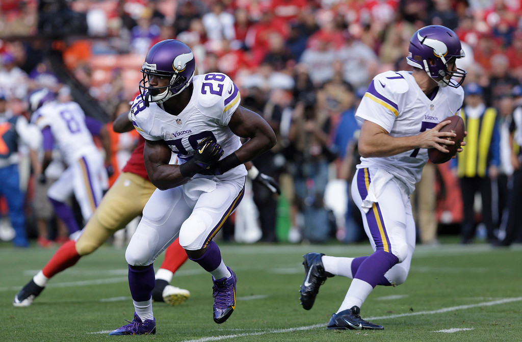 . Vikings running back Adrian Peterson splits right on a fake handoff from quarterback Christian Ponder during the first quarter against San Francisco. (AP Photo/Jeff Chiu)
