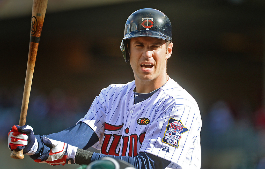 . Minnesota first baseman Joe Mauer questions a strike call by home plate ump Bill Miller in the fourth inning at Target Field in Minneapolis, April 7, 2014. Mauer went hitless with two strike outs in the Twins 8-3 loss to Oakland. (Pioneer Press: John Autey)