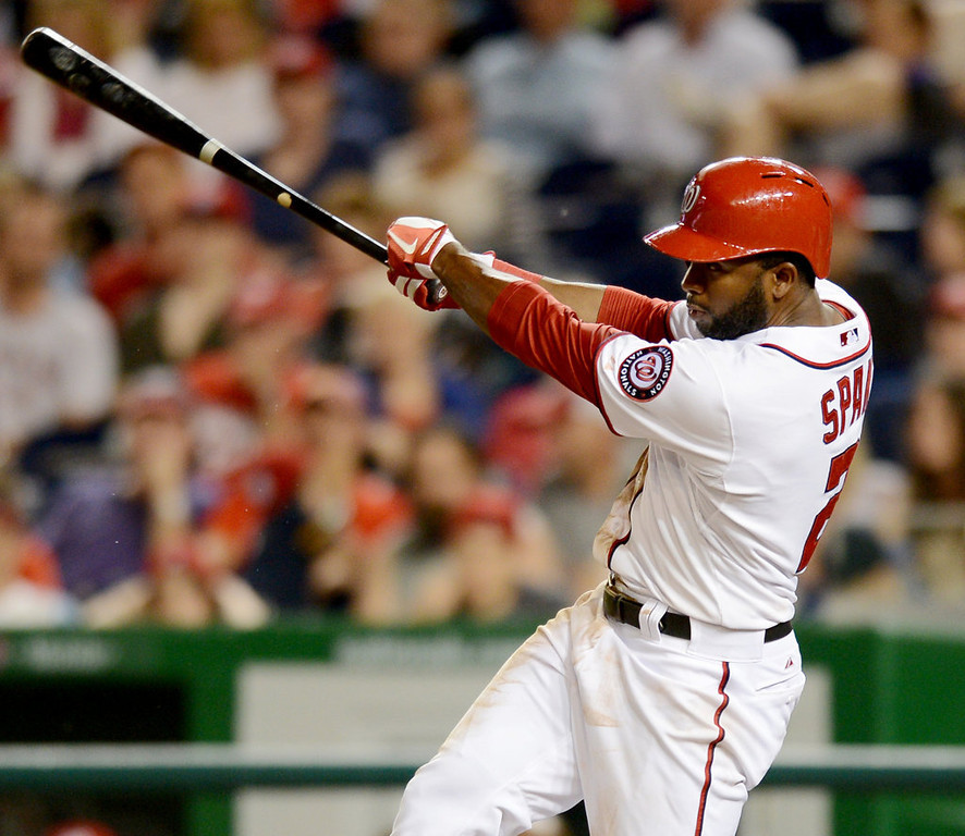 . Washington Nationals center fielder Denard Span (2) drives a ball deep for an RBI triple against the Minnesota Twins in the sixth inning of the second game of a day-night doubleheader. (Chuck Myers/MCT)