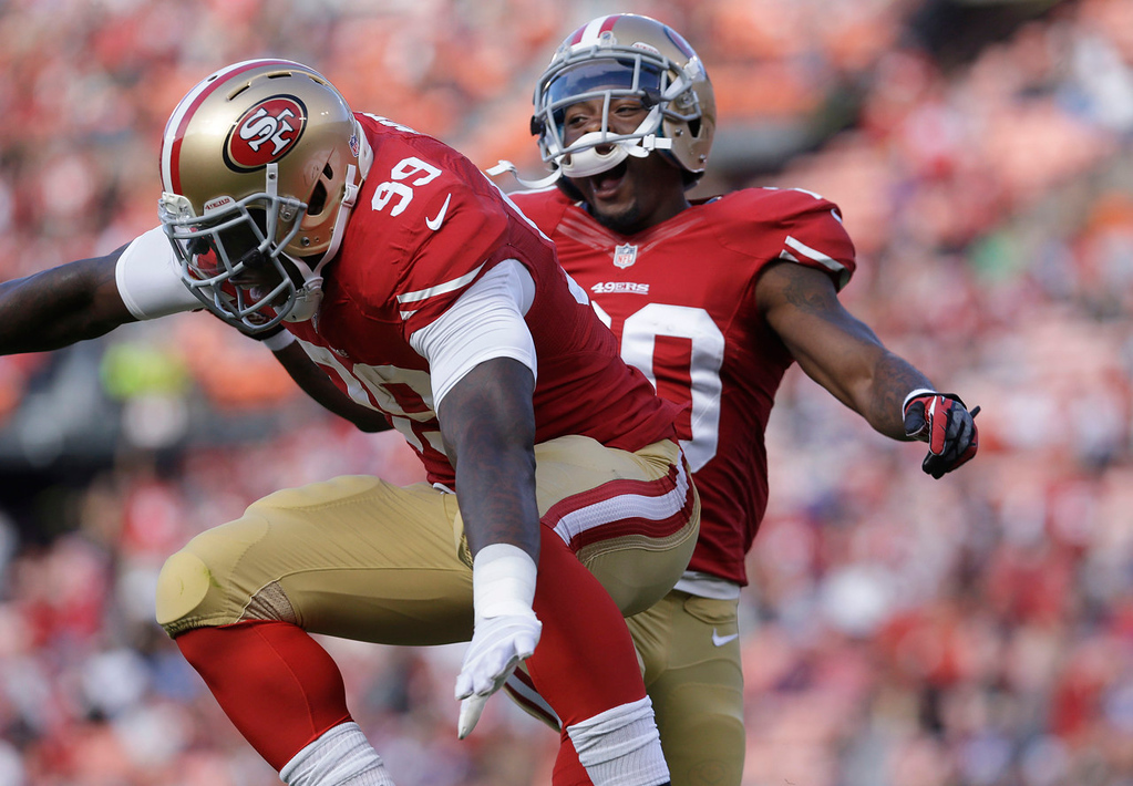 . 49ers linebacker Aldon Smith celebrates  with defensive back Perrish Cox after recovering a fumble by Vikings quarterback Christian Ponder during the first quarter. (AP Photo/Jeff Chiu)