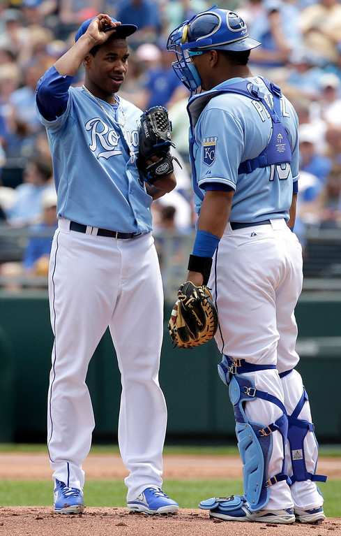 . Kansas City Royals starting pitcher Yordano Ventura, left, talks with catcher Salvador Perez during the first inning. (AP Photo/Charlie Riedel)