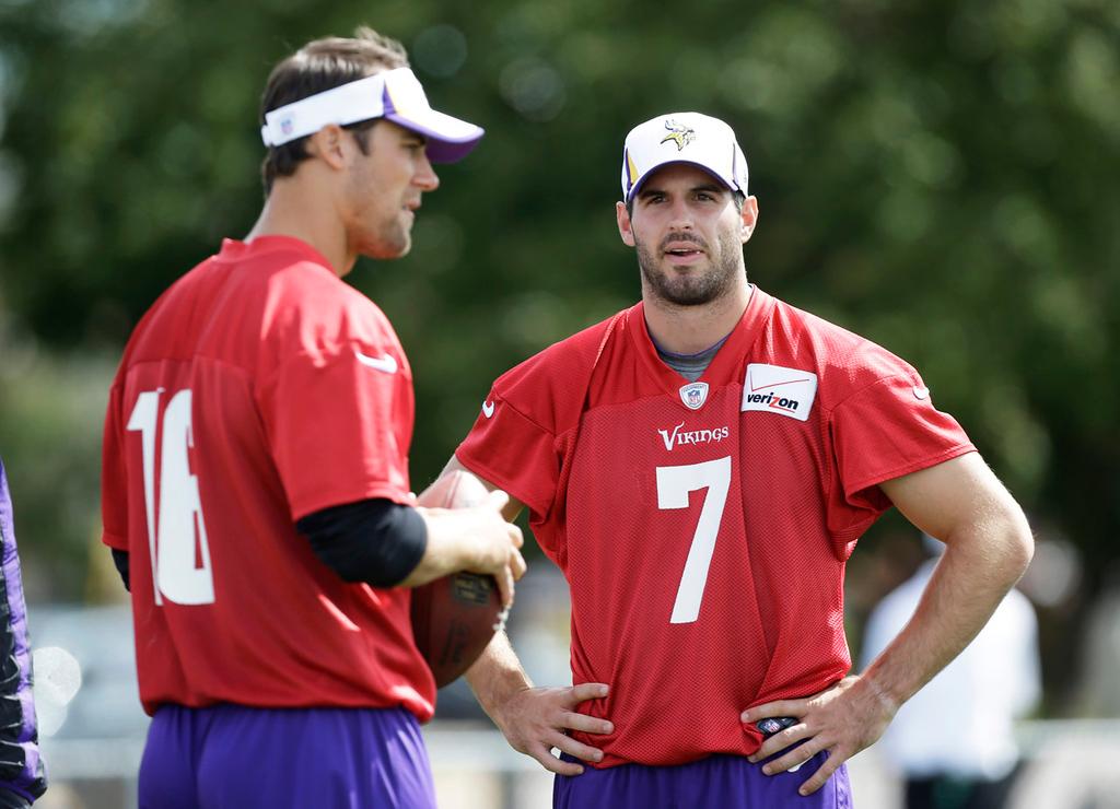 . Vikings quarterbacks Christian Ponder, right, talks with backup quarterback Matt Cassel during drills. (AP Photo/Charlie Neibergall)