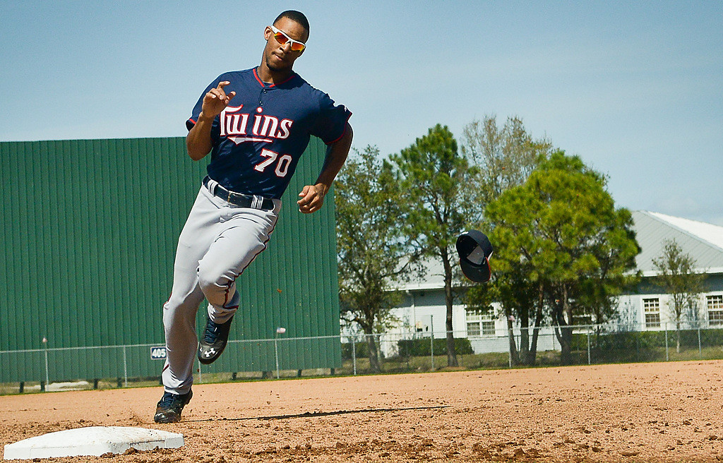 . Twins rookie Byron Buxton loses his hat as he rounds the bases during drills. (Pioneer Press: Ben Garvin)