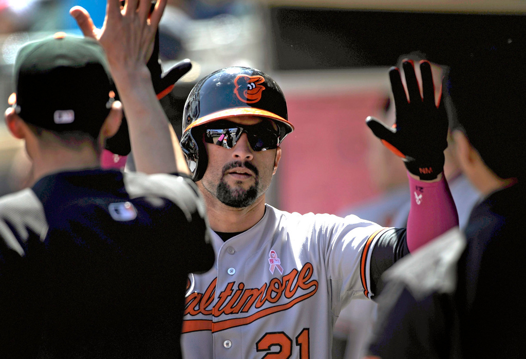 . Baltimore\'s Nick Markakis celebrates after scoring on a bases-loaded ground out against the Twins during the fifth inning. (Photo by Hannah Foslien/Getty Images)