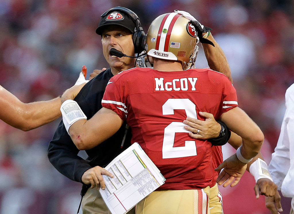 . 49ers head coach Jim Harbaugh celebrates with quarterback Colt McCoy, who threw a four-yard touchdown pass to Jewel Hampton on the first play of the fourth quarter against the Vikings.  (AP Photo/Marcio Jose Sanchez)
