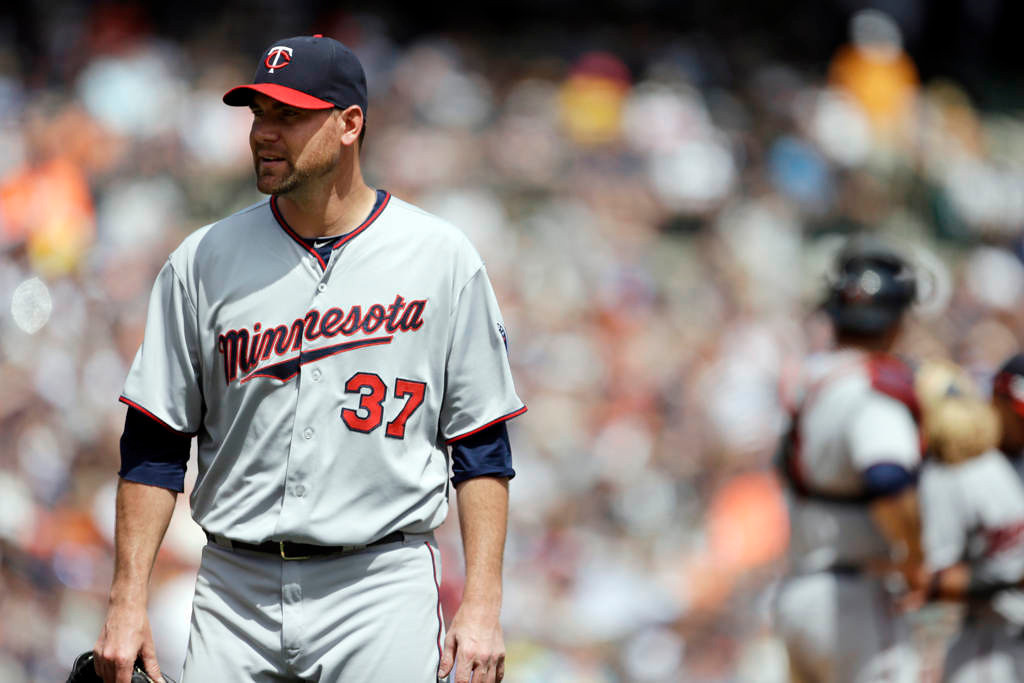 . Minnesota Twins starting pitcher Mike Pelfrey walks back to the dugout after being pulled during the sixth inning of a baseball game against the Detroit Tigers in Detroit, Sunday, May 26, 2013. (AP Photo/Carlos Osorio)