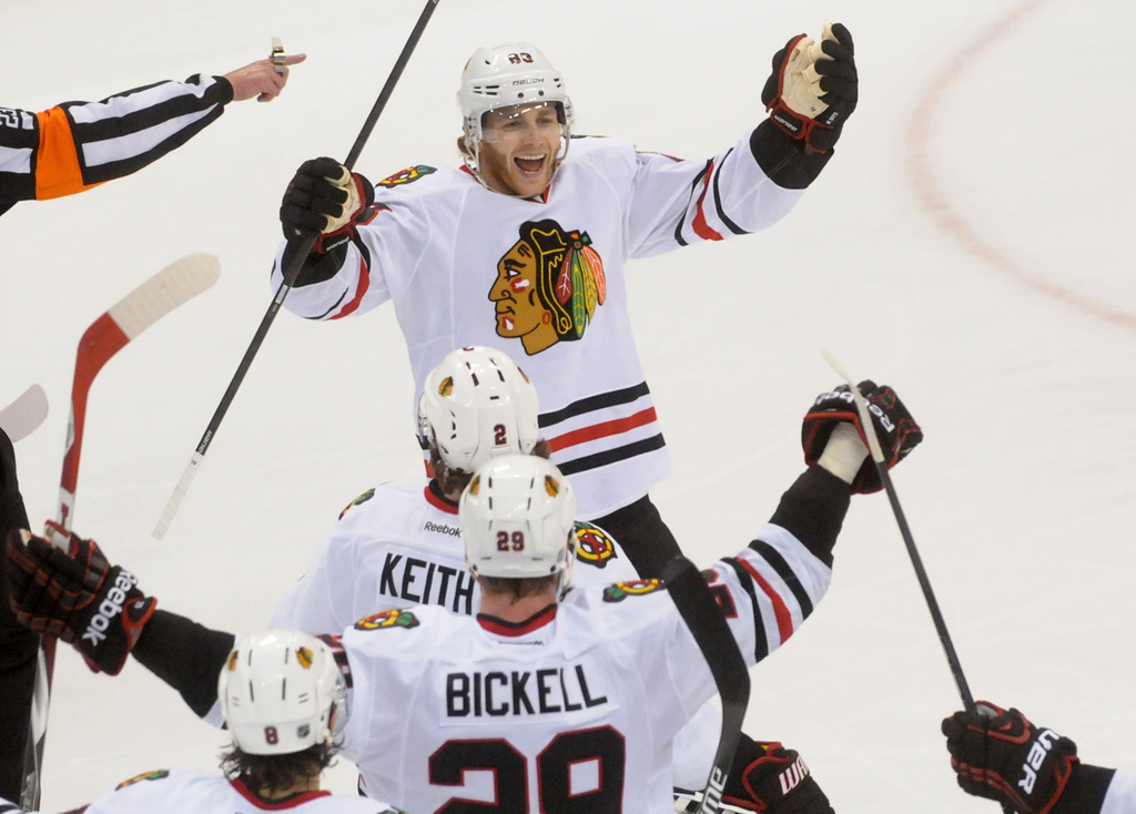 . Chicago\'s Patrick Kane, top, celebrates his game winning goal at 9:40 of the overtime period to beat the Minnesota Wild in Game 6.   (Pioneer Press: Sherri LaRose-Chiglo)