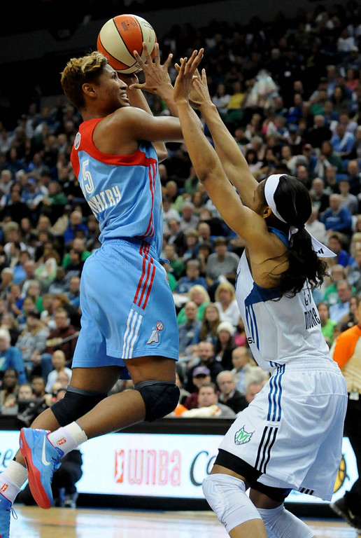 . Minnesota forward Maya Moore blocks Atlanta guard Angel McCoughtry during the third quarter. (Pioneer Press: Sherri LaRose-Chiglo)