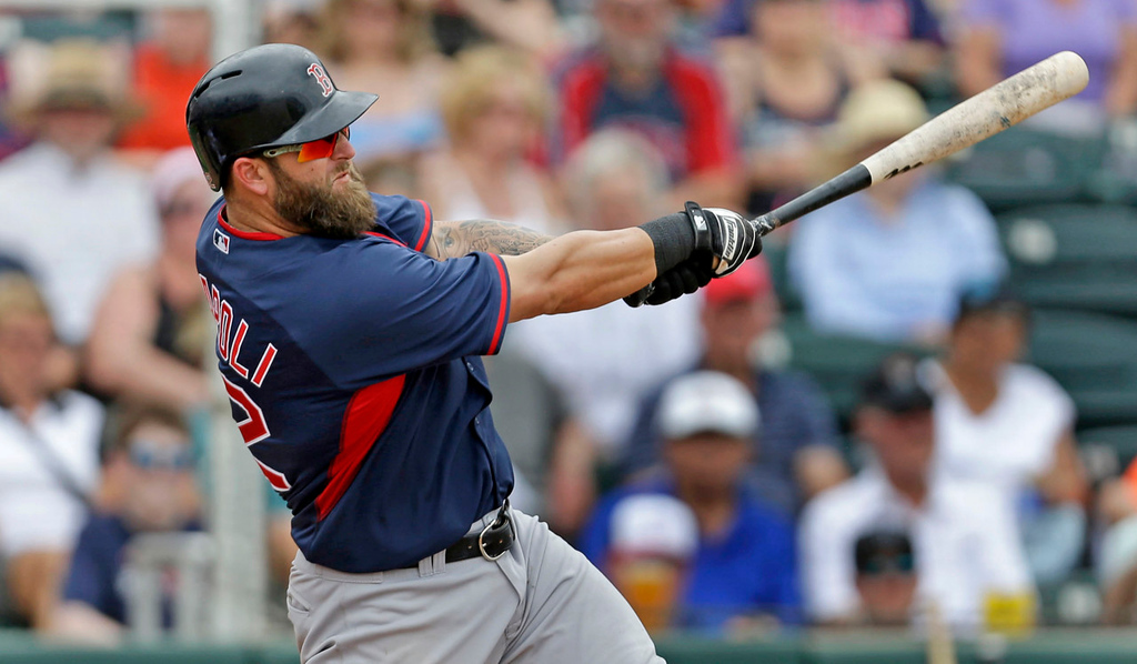 . Boston\'s Mike Napoli connects for a solo homer off Twins starter Phil Hughes in the sixth inning of the Red Sox\'s 4-0 win at Hammond Stadium in Fort Myers, Fla. on Friday, March 28, 2014. (AP Photo/Gerald Herbert)